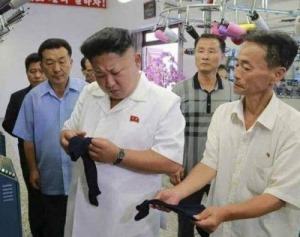 Kim Jong Un loojking at a sock